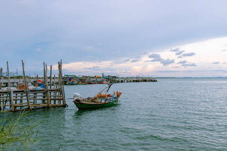 A fishing boat in the sea and the evening sky with a vast sea view in Thailand.