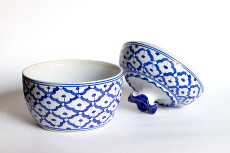 Ceramic cup with lid on a white background