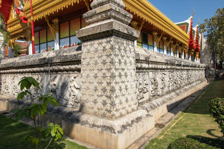 The beauty of the wall beside the LDS at Wat Phanancheng Worawihan in Phra Nakhon Si Ayutthaya Province, Thailand Stock Photo