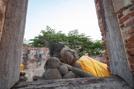 Buddha images seen through old LDS windows at Phuttha Sawan temple in Phra Nakhon Si Ayutthaya Province, Thailand Stock Photo