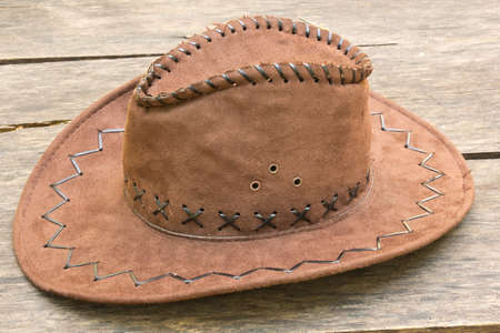 western attire: the hat on wood background