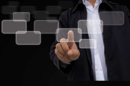 hand pushing a button touch screen Stock Photo