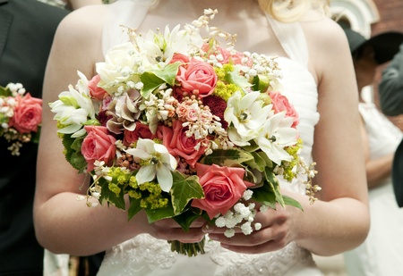 bride holding bunch of flowers at a wedding photo