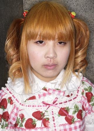 harajuku: TOKYO - CIRCA MAY 2008: Unidentified Japanese girl in Cosplay outfit poses in Harajuku fashion district in Tokyo circa May 2008. Cosplay is a trend for dressing like Cartoon, Movie or Pop characters
