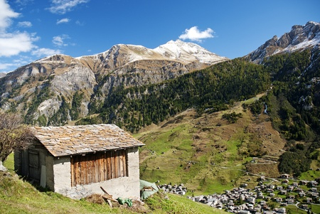 vals village in switzerland alps with alpine mountain landscape photo