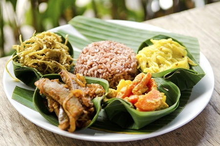 indonesian food: indonesian food in bali, several curries and rice