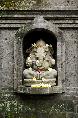 god figure: ganesh hindu god figure in bali indonesia temple Stock Photo
