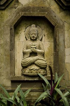 buddha image in bali indonesia garden photo
