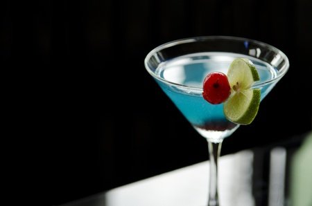 cocktails: blue cocktail drink with cherry and lime