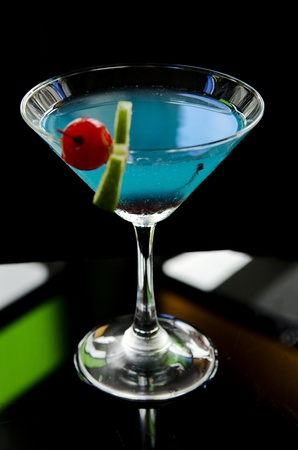 blue cocktail drink with cherry and lime photo