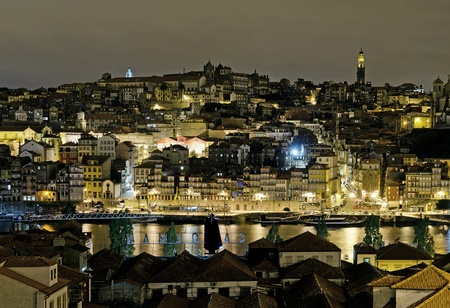 porto riverside by night in portugal photo
