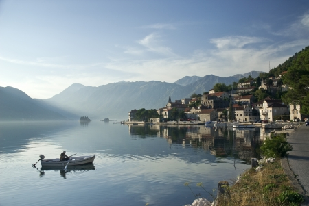 View of perast village in the bay of kotor in montenegro with fjord and fisherman