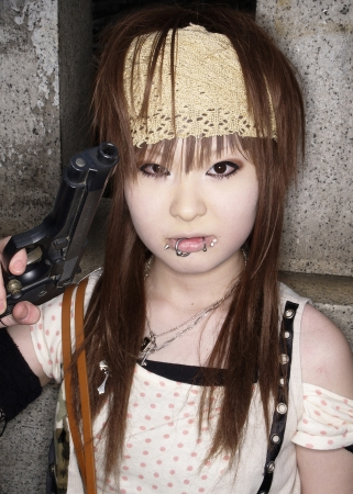 cosplay: Japanese girl in Cosplay outfit poses for photo in Harajuku fashion district in Tokyo