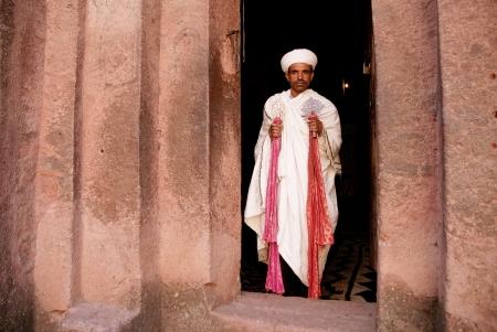 priest at lalibela churches in ethiopia