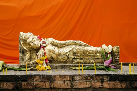 reclining buddha statue with gold leaf in thailand photo