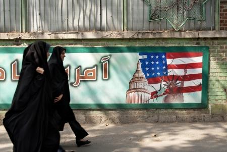 streetscene: anti american mural in tehran iran with veiled women Editorial