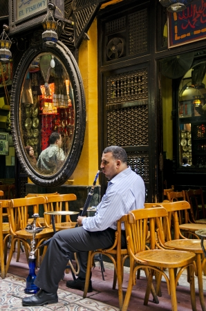 business man smoking in cairo egypt