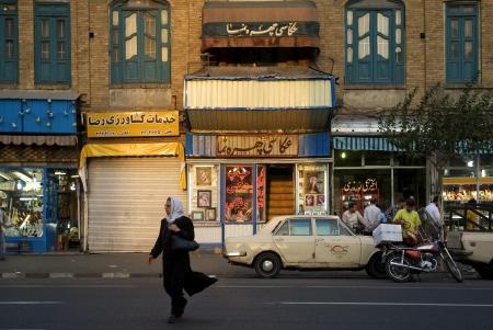 woman on street in central tehran iran