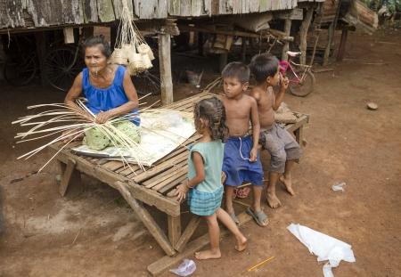 elderly woman weaving basket in cambodia village Stock Photo - 13684902