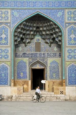 esfahan: man cycling by mosque esfahan iran Editorial