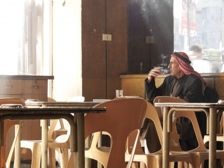 man smoking in aleppo syria cafe