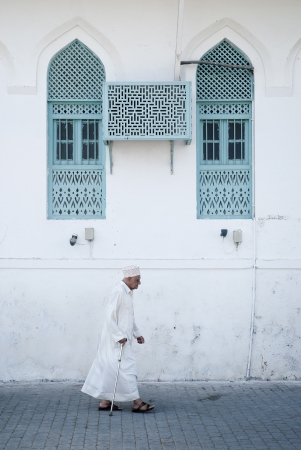 Oman: old man on street in muscat oman