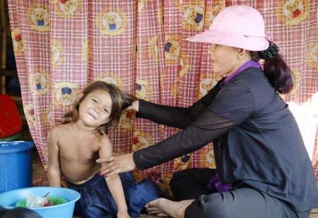 girl and mother in pnomh penh market cambodia Stock Photo - 14541740