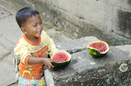 asian child eating watermelon fruit in cambodia Stock Photo - 14541705