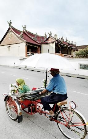streetscene: bicycle taxi in penang malaysia