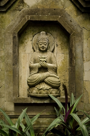 buddha image in bali indonesia garden photo