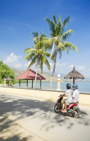 areia branca beach and scooter near dili east timor Editorial