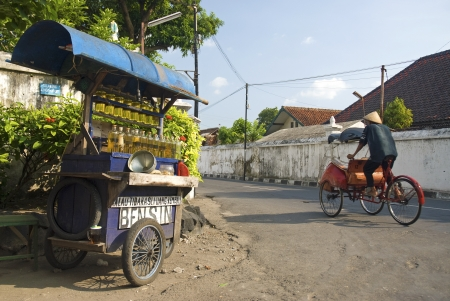 petrol stall and cyclo becak taxi in solo city indonesia Editorial