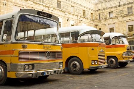 vintage yellow british buses in valetta malta Editorial