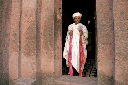 priest at ancient rock hewn churches of lalibela in ethiopia