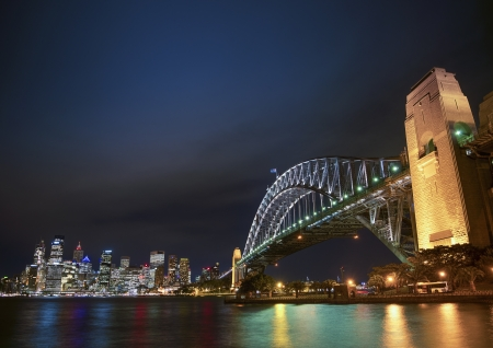 harbour bridge and skyline of sydney in australia at night photo