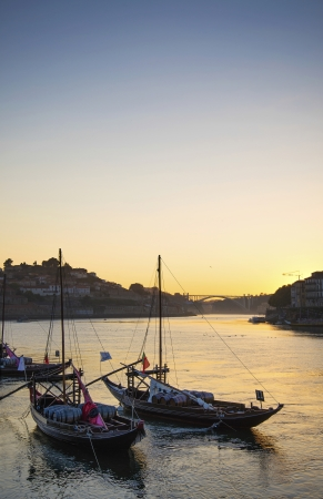 rabelo: old town river area of porto portugal with rabelo boats at sunset