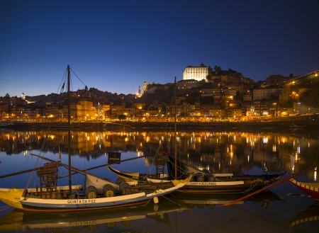 rabelo: old town river area of porto in portugal at night with rabelo boats