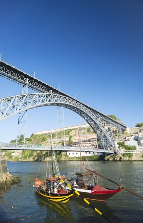 rabelo: dom luis bridge and rabelo boats in porto portugal