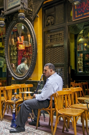 business man man smoking in cairo cafe in egypt