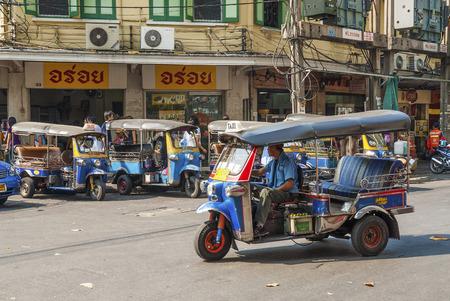 tuk tuk taxis on street in bangkok thailand