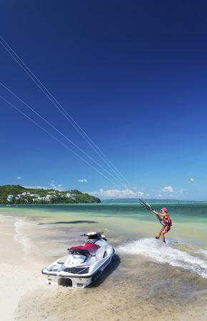 boracay: kitesurfing man in  tropical bulabog beach boracay island philippines