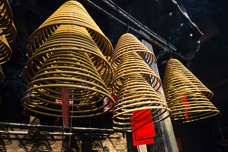 coils: chinese incense coils burning in a-ma temple in macao china