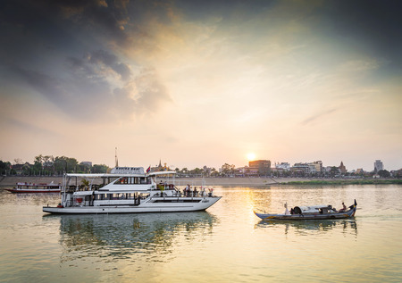 tourist boat on sunset cruise in phnom penh cambodia river