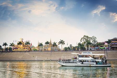 tonle sap: tourist boat on sunset cruise in phnom penh cambodia tonle sap river