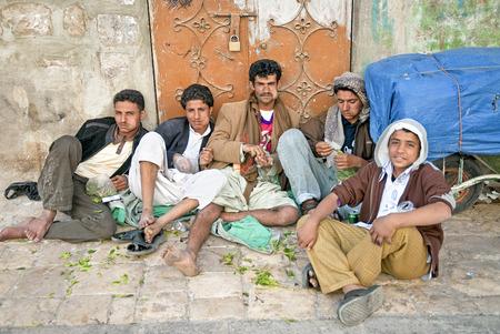 boys chewing khat qat leaves in street of sanaa old town yemen