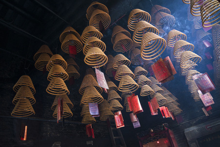 macao: incense coils burning in a-ma chinese temple in macao china