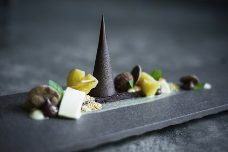 fine cuisine: gourmet chocolate, fruit and nuts dessert platter