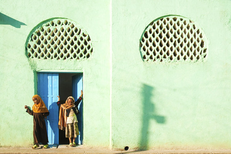 veiled: veiled girls by mosque in harar in ethiopia