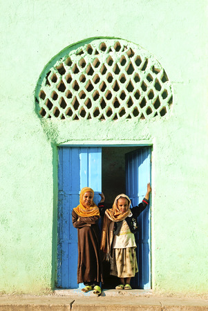 veiled: veiled children by mosque in harar in ethiopia Editorial