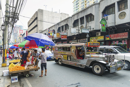 manila: local colourful jeepney bus in manila chinatown street in philippines